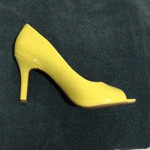 Yellow open toed heels.